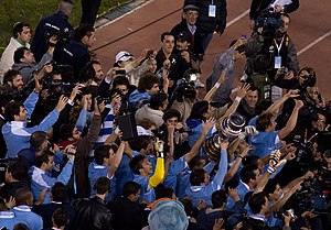 2011 Copa América - Uruguayan players celebrating their 15th Copa America title.