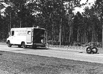 Road texture - A van pulling a road profilometer (undated, before 1969).