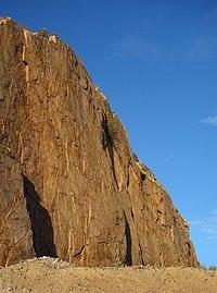 Vertical granite cliff at sunset.jpg