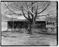 View of south rear - Trail Shop, Guest Cabin, 105' east of Northwest corner of Lodge, Cody, Park County, WY HABS WYO,15-CODY.V,3B-3.tif