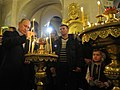 Vladimir Putin attends Christmas service at the Transfiguration Cathedral in St Petersburg.jpeg