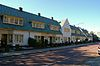 Complex Akkerstraat: drietal blokken met woonhuizen opgetrokken in Traditionalistische stijl