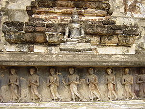 Bas-relief in Sukhothai, Thailand depicting monks during walking meditation.