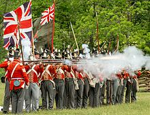 "Re-enactors in UK uniforms fire muskets toward the ""Americans"" in this annual commemoration of the June 6, 1813 Battle of Stoney Creek."
