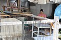 Weaving traditional Laotian garments (14419334228).jpg