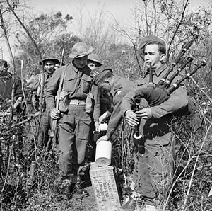 13th Infantry Brigade (United Kingdom) - While a piper plays, a special rum ration is issued to men of the 2nd Battalion, Royal Inniskilling Fusiliers to mark St Patrick's Day in the Anzio beachhead, Italy, 17 March 1944.