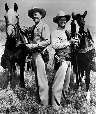 Harry Lauter - Lauter (right) with Willard Parker in Tales of the Texas Rangers, 1957.
