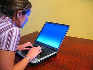 300px Woman typing on laptop China made laptop, netbooks, UMPC supplier list, price, wholesale dealer and quality review