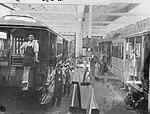 Workmen constructing Sydney tram cars (5570142479).jpg