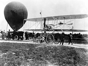 History of aviation - The Wright Military Flyer aboard a wagon in 1908.