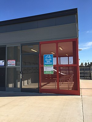 Bicycle parking station - Simple: A Parkiteer e-card-accessible bike cage at Wyndham Vale station, Melbourne, Australia.