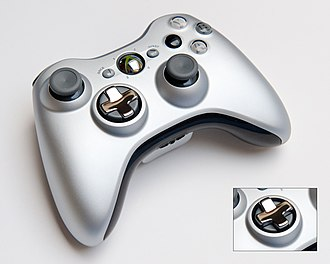 """Xbox 360 controller - Transforming d-pad special edition controller in """"8-way"""" configuration. The d-pad in """"4-way"""" configuration is shown in the bottom right corner."""