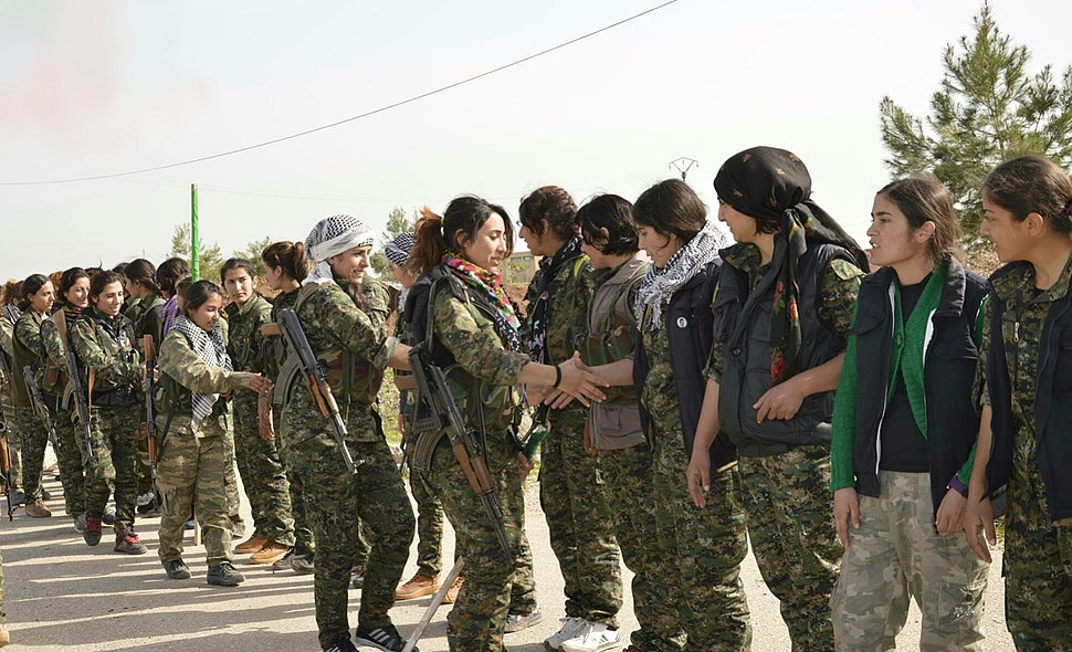 YPJ fighters shake hands with one another