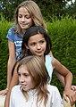 Young girls posing in the garden.jpg