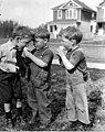 """Twin boys and friend eating ice cream cone, Edmonton"" (18762802684).jpg"