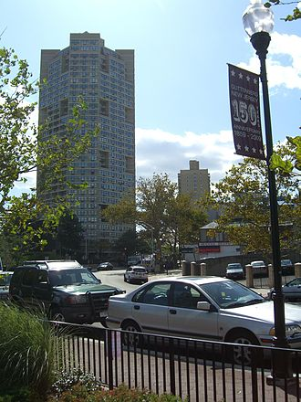 Guttenberg, New Jersey - A 2009 sign on Boulevard East advertising the town's 150th anniversary. In the background is one of the three towers of the Galaxy apartments.