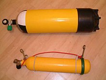 Two steel cylinders are shown: The larger is about twice the diameter of the smaller, and about 20% longer.