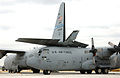 166th Airlift Wing C-130 Hercules stuck under another's tail due to tornado damage.jpg