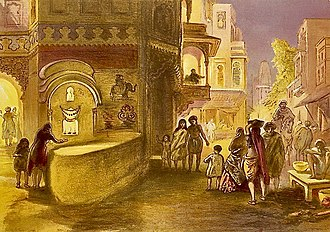 "William Simpson labelled his chromolithograph of 1867 CE as ""Dewali, feast of lamps"". It showed streets lit up at dusk, with a girl and her mother lighting a street corner lamp. 1867 CE chromolithograph, Diwali, feast of lamps, by William Simpson.jpg"