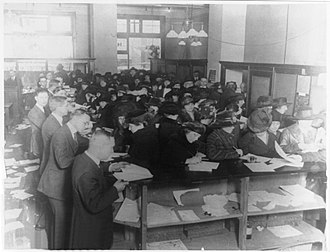 Income tax in the United States - People filing tax forms in 1920.