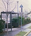 1970s-style TriMet bus stop sign and shelter.jpg