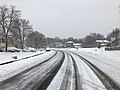 2018-03-21 10 11 00 View east along a snow-covered Kinross Circle (Virginia State Route 6651) at Allness Lane (Virginia State Route 6652) in the Chantilly Highlands section of Oak Hill, Fairfax County, Virginia.jpg