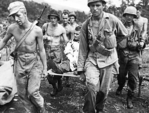 11th Airborne Division (United States) - Troops of the 511th Parachute Infantry Regiment evacuate a wounded soldier to an aid station at Manarawat on the island of Leyte, December 1944.