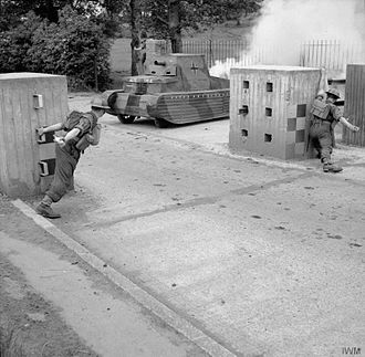 61st Infantry Division (United Kingdom) - Men of the 6th Royal Berkshire Regiment, manning a roadblock, practice attacking German tanks.