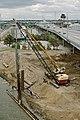 87j126 driving sheet piles (8013430769).jpg