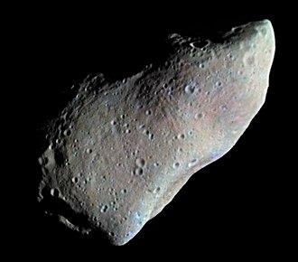 Asteroid belt - 951 Gaspra, the first asteroid imaged by a spacecraft, as viewed during Galileos 1991 flyby; colors are exaggerated