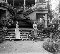 A. Mikhalkova and N. Khlebnikova with bicycles at the stairs at home in the estate Petrovskoe.JPG