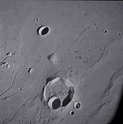 Krieger crater and vicinity, showing wrinkle ridges in the surrounding mare and sinuous rilles along the left edge.