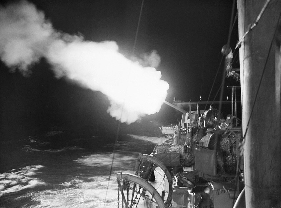 A 4.7-inch gun onboard HMS JUPITER firing on enemy shipping in the port of Cherbourg, on the night of 10-11 October 1940. A1010