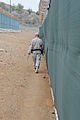 A Guard Force soldier patrols behind sniper netting in Camp VI Detention Facility at Naval Station Guantanamo Bay, Cuba, April 9 2013 130409-A-TE537-059.jpg