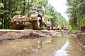 A U.S. Army Husky improvised explosive device detection vehicle, assigned to 1221st Route Clearance Company, South Carolina Army National Guard, leads a convoy during route clearance operations at McCrady 140624-Z-XH297-006.jpg