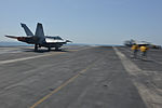 A U.S. Navy F-A-18C Hornet aircraft attached to Strike Fighter Squadron (VFA) 37 launches from the flight deck of the aircraft carrier USS Harry S. Truman (CVN 75) in the Gulf of Oman March 10, 2014 140310-N-CC806-047.jpg