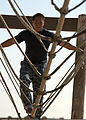 A U.S. Navy petty officer first class, selected for promotion to chief petty officer, balances as he transits an obstacle course during the San Diego Chief Petty Officer Legacy Academy at Naval Base Coronado 130822-N-ZF681-179.jpg