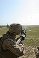 A marine shoots a M32 grenade launcher at Fort Bragg.jpg