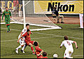 Adam Morgan holds up the ball.jpg