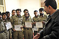 Afghan National Police 1st Lt. Sardar Hotak, the chief of police for Shah Joy district, speaks with new members of the Afghan Local Police (ALP) during a graduation ceremony at the Shah Joy district center in 120129-N-CI175-150.jpg