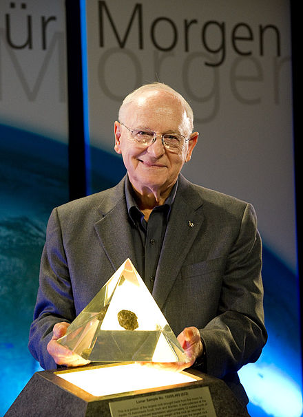 Bean presents a piece of Moon rock at the Gasometer Oberhausen in March 2010 AlanBean0005.jpg