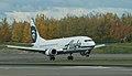 Alaska Air 737 Combi landing at ANC (6863695599).jpg