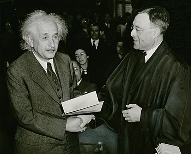 Newly naturalized citizen Albert Einstein received his certificate of American citizenship from Judge Phillip Forman. Albert Einstein citizenship NYWTS.jpg
