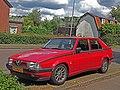 Alfa Romeo 75 2.0 (14080569818).jpg