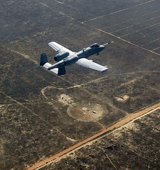 Eglin Air Force Base - An A-10C Thunderbolt II, piloted by the 40th Flight Test Squadron, flies over what's left of a target that was successfully hit by a Laser Joint Direct Attack Munition drop on the Eglin range.