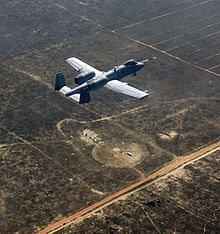 An A 10C Thunderbolt II, piloted by the 40th Flight Test Squadron, flies over what's left of a target that was successfully hit by a Laser Joint Direct