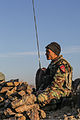 An Afghan National Army commando with the 1st Tolai, 3rd Special Operations Kandak mans a radio during a clearing operation in the Shah Wali Kot district of Kandahar province, Afghanistan, Nov. 11, 2013 131111-A-XP635-082.jpg