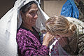 An Afghan woman, left, shows her baby to U.S. Army Spc. Helen Jeschow, an information support operations specialist with the 340th Tactical Military Information Support Operations Company, Task Force Tsunami 120603-A-ZU930-007.jpg