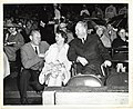 An unidentified man speaks with Mary Collins and Mayor John F. Collins in Fenway Park (13910960375).jpg