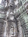 Angkor - Ta Prohm - 024 Tower and Apsaras (8580857653).jpg